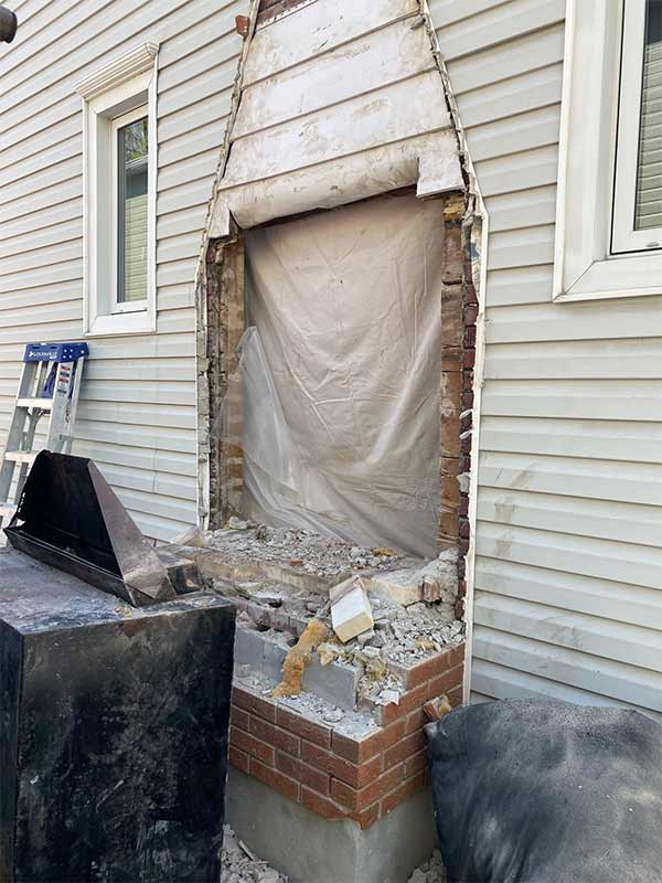 Hole in siding from chimney removal requiring repair
